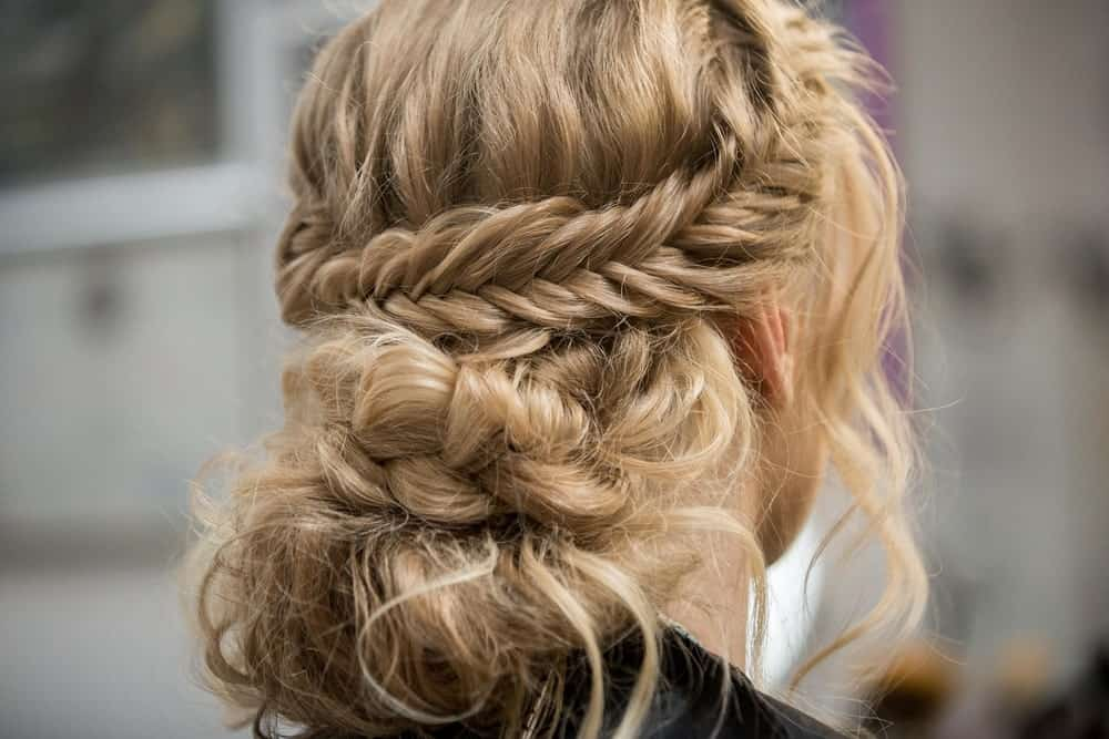 The wraparound braid is one of the most preferred hairstyle for fancy events. However, you can rock this look for casual outings as well. Twist a thick lock of hair into a braid around your head, and for a casual look, pull a few strands loose to frame your face. If you want, you can make further braids form the loose hair or just let it flow down.