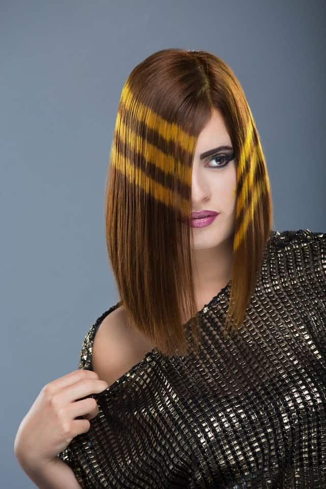 If bright and vivid hair colors are not your style, then consider adding just a touch of flamboyancy as shown in the example above. Note that the key is to get a slant bob for an overall sleek and chic look.