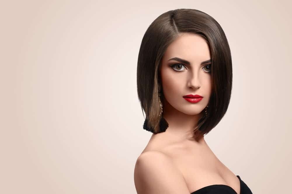 This is another gorgeous brunette bob with a side parting and equal length from both sides. The hair has been back-combed from the top that make it look slightly thick and voluminous.