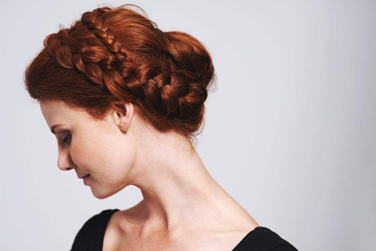 You can make a bun in so many different ways. This hairstyle uses a braid as a headband with a simple bun on the back for a gorgeous look.