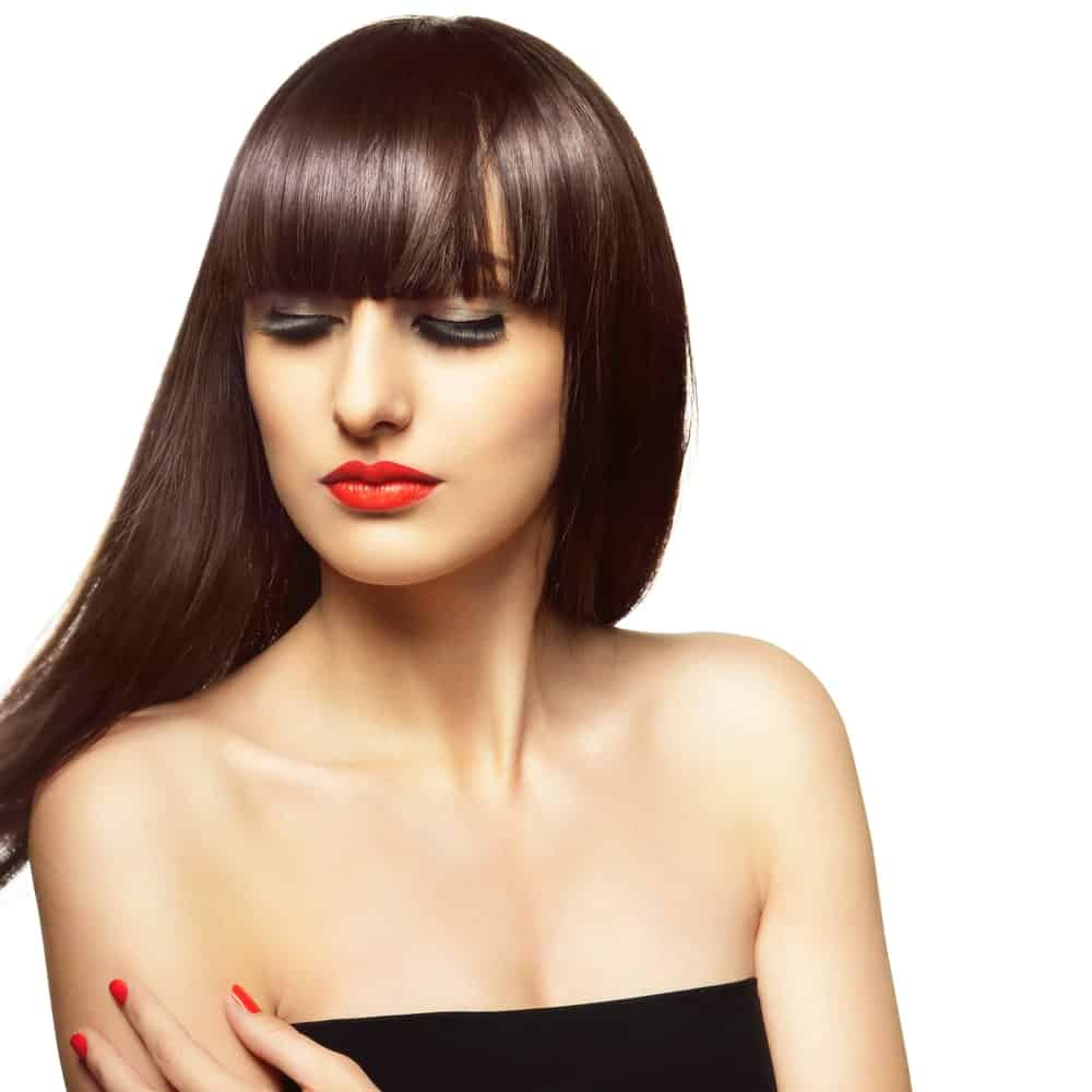 With sleek, straight and equal length bangs in the front and all the remaining hair been thrown towards the back, this hairstyle is just stunning and is perfect for anyone with a fairly small face.