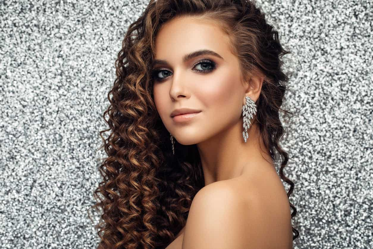 If your hair is long as well as thick, style it in some long corkscrew curls. The great thing about this hairstyle is that it does not just add dimension to your hair but it also gives your hair a springy and bouncy impression.