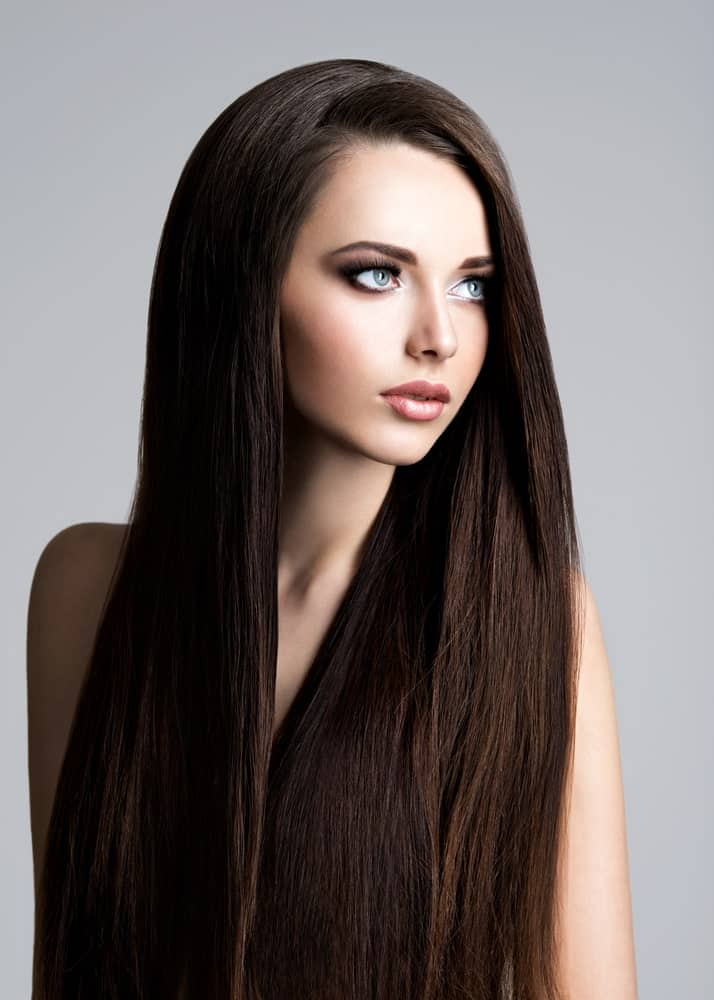 This is an absolutely gorgeous hairstyle with a side parting and more than half of the hair thrown over to the left side. If you have thick and voluminous hair, this style is perfect for you.