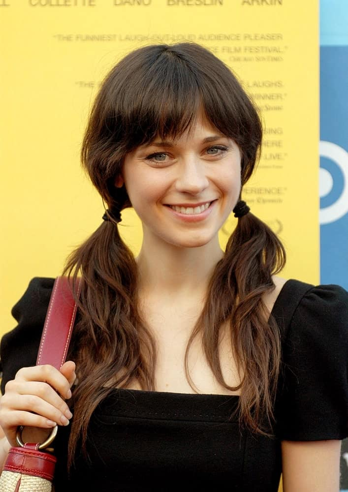 She can never go wrong with bangs. Here, Zooey sports a lovely, refreshing look with bangs and two ponytails. While the bangs bring focus to her eyes, the ponytails add a charming touch.