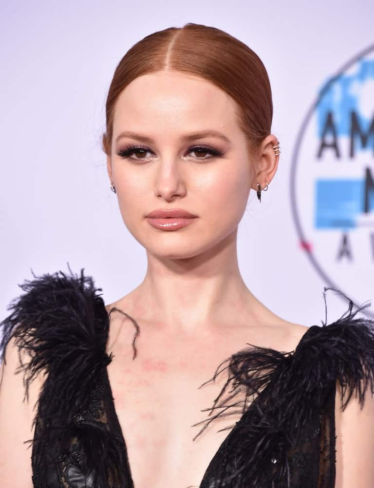 Natural redhead Madelaine Petsch looks ethereal with a slicked back ponytail and a crisp side parting. It's a classic look when you want to look glamorous but elegant.