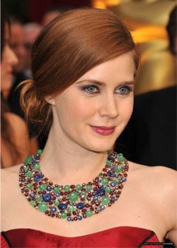 On days that you don't feel like wearing your long hair down, tie it up neatly just like Amy Adams did at this award show. To counter the simplicity, pair the style with some bold and heavy jewelry.