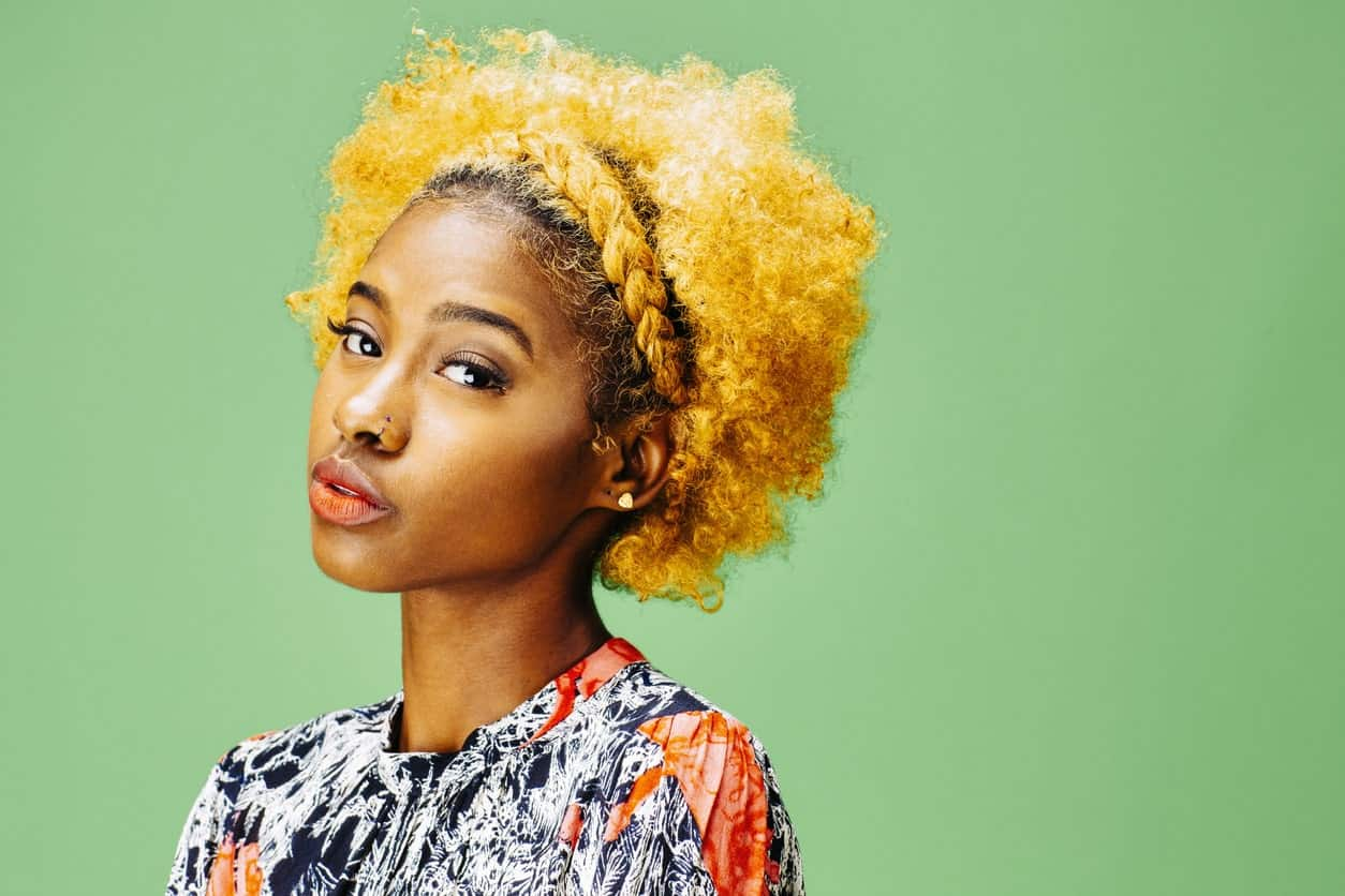 Tight coils can also be piled up in a neat bun. Pull back the hair and use lots of pins to secure the hair on top of your head.
