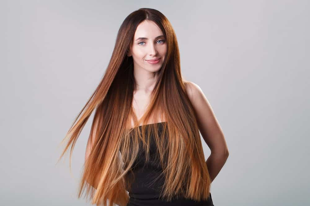 If you have super-long hair, then you have more room to play with it. Ask your stylist to transition your hair from a deep chestnut, to a dark ginger, to a fiery auburn and finally to strawberry blonde. The effect is absolutely breathtaking.