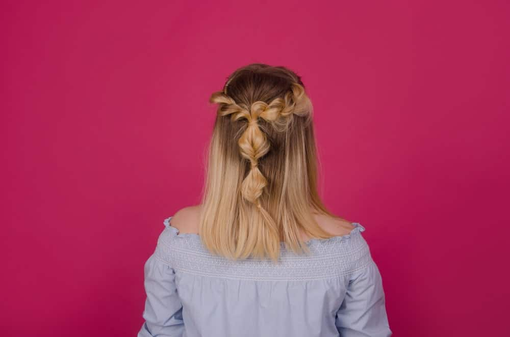 This sweet and casual style is one of the most effortless ways to create a bohemian look. Just take a few locks from the sides of your head and plait them into a loose braid. Then bring them together at the back of the end and tie them together. Twist and tie the loose hair into soft and loose knots.