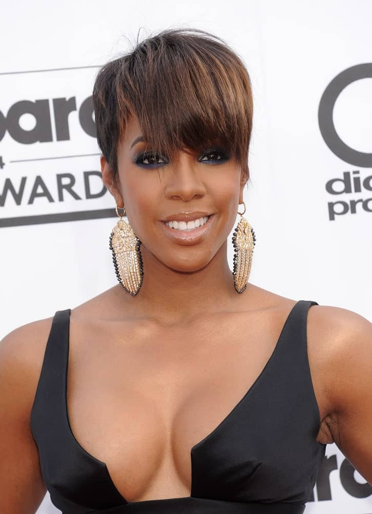 All you need to balance your short cropped hair is full front bangs. Check out the stunning Kelly Rowland withher short hair and bangs, completing the look with large earrings.