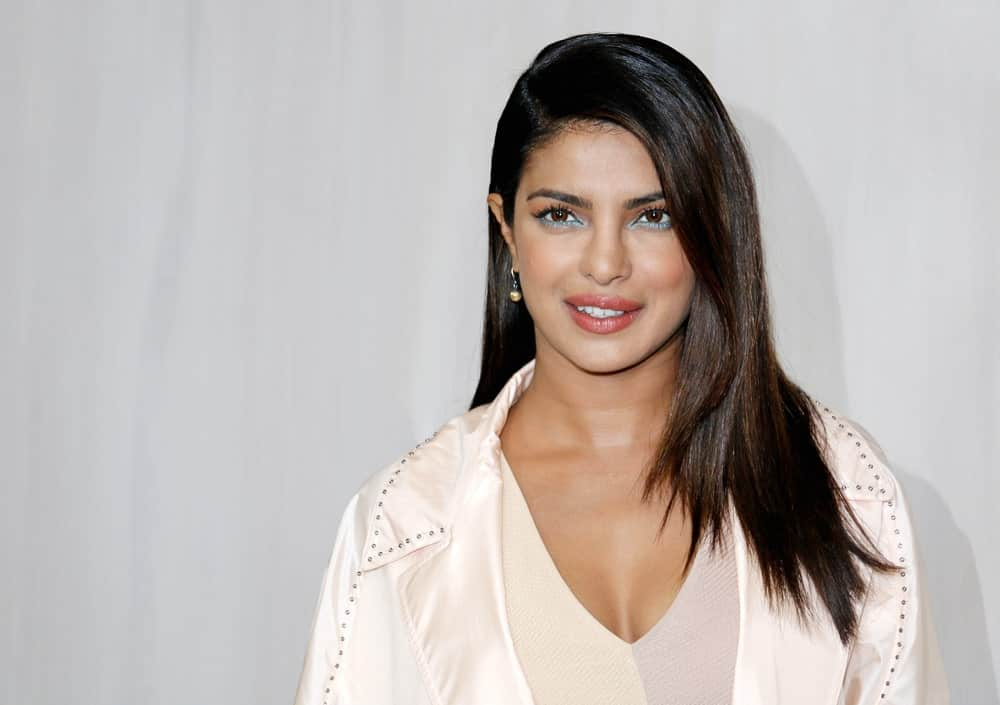 The Indian actress had her stylist give her layers with choppy ends. She then gave her hair a deep part from the side and let her dark brown locks tumble to the side on her shoulder.