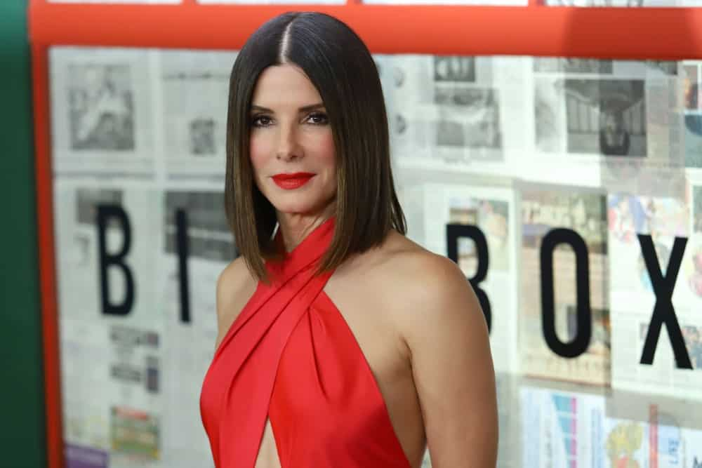 "While you may have loved Sandra Bullock in her excellent movie ""The Proposal"", you will love her even more for this gorgeous straight brunette hairstyle of hers. It is nothing but a clean and classy long bob with a very sharp middle parting. The hair appears to have been styled slightly inwards, towards the face. Beautiful and modern are two words that best describe this hairstyle."