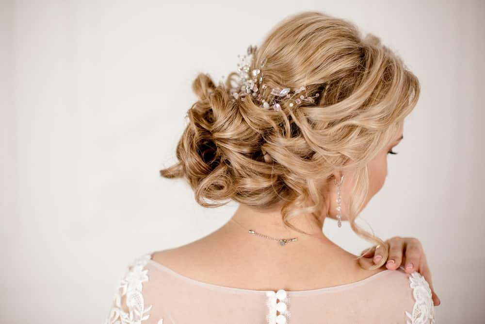 If you have a bit of time on your hands, why not opt for an elaborate updo, if you are attending a party or a wedding? Take a look at this beautiful style filled with knots, twists and turns and embellished with bejeweled accessories.