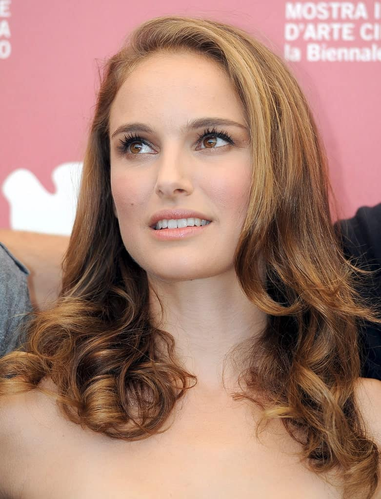 Flickr, Greg Razzi Natalie Portman drops hints for a classy side-swept hairstyle with her perfect, blowout and lustrous locks.