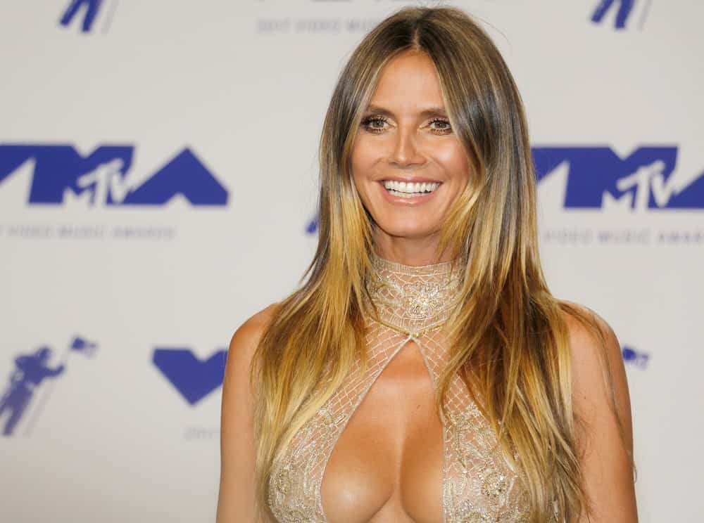 Do you have bangs that are so long they get in your eyes if you try to style them across your forehead? Copy Heidi Klum's style by ironing them out straight and then parting them in the middle to incorporate them seamlessly into your hair. They look even better if you have layers.