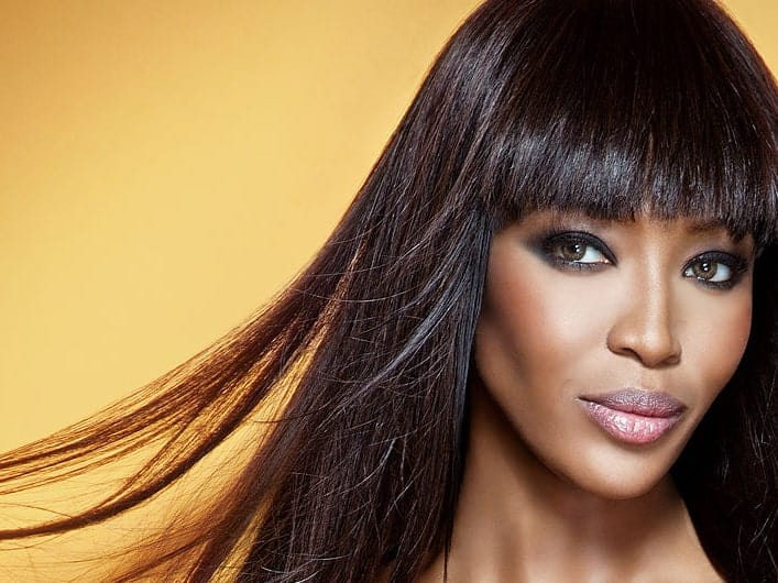 Naomi Campbell is known for her radiant smile and her thick, long and super-black hair. The supermodel loves to flaunt her super-long Rapunzel hair by keeping it relaxed, smooth, shiny and glossy.