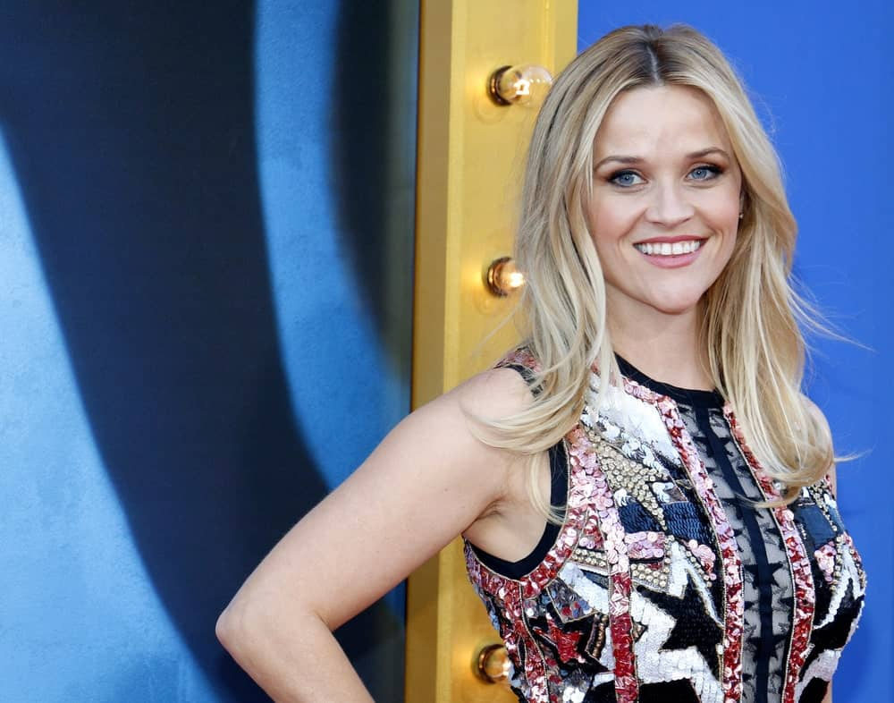 For a cool, casual and sassy style, try Reese Witherspoon's middle-parted blown out hair. Part your hair in the middle and tease the hair on the back of your head for a little lift. Then blowout your locks and spray them with some hair product to keep them in place.
