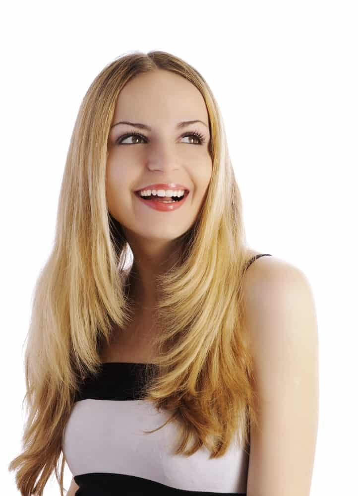 This hairstyle is great for people with long hair who want a little volume in their hair. It has been parted in the middle with really long, sleek and straight layers going down below.