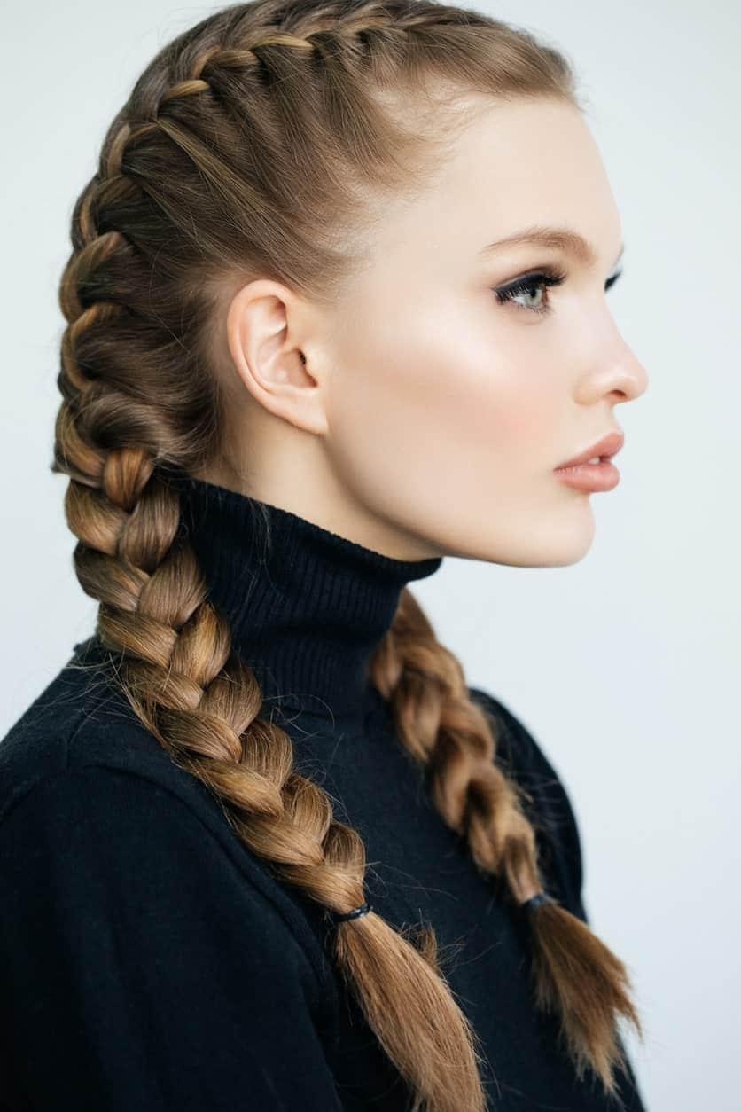 Hairstyles with two French braids have been really popular among celebrities like Kim Kardashian and Lily Singh since they look absolutely chic. Auburn French braids always look really elegant and keep the hair out of your eye while you're working.