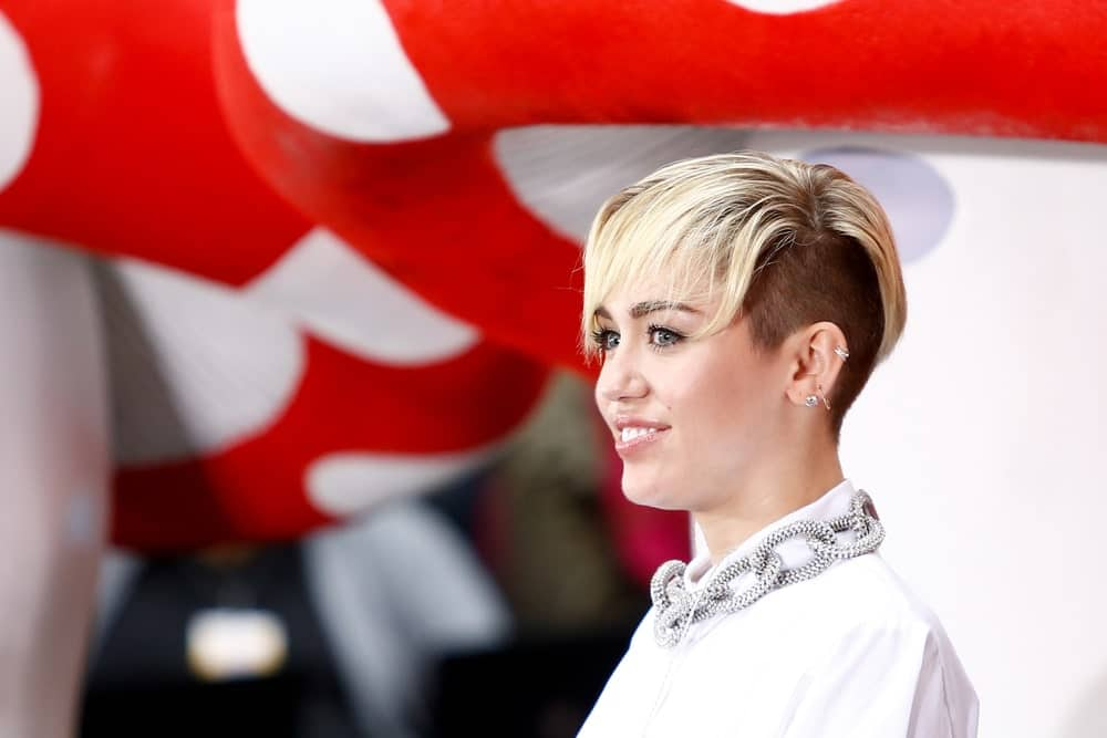Want to take it a step further? Shave one side of the head to sport short cropped hair and balance it off with elegant bangs covering your forehead. Miley truly pulls off this hairstyle!