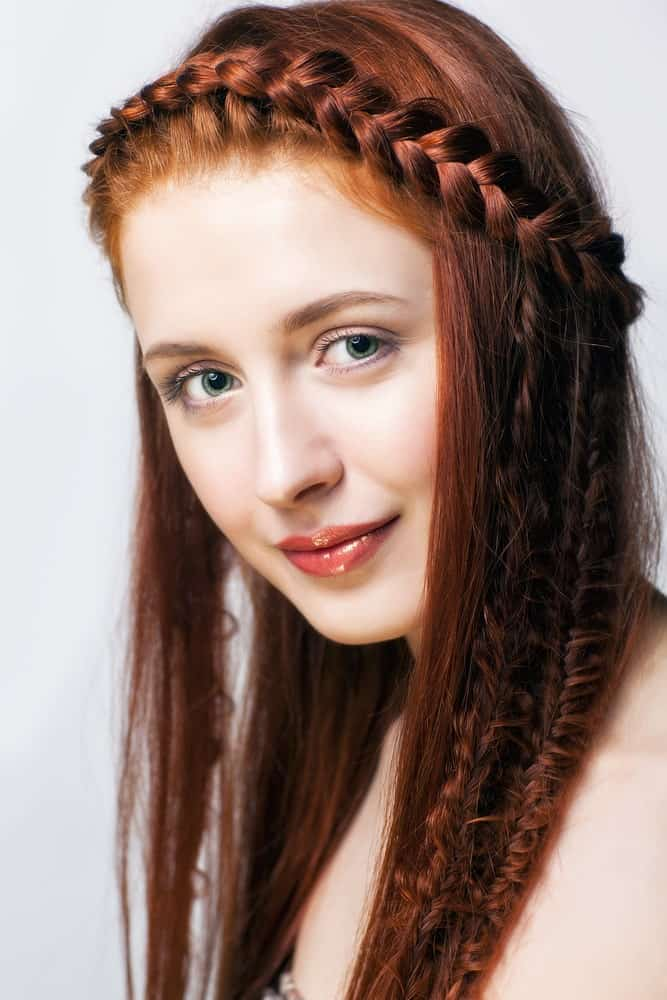 A braided headband running right at the front of the hairline can pop even more if you add a few delicate braids between your natural hair for an interesting addition to the hairstyle.