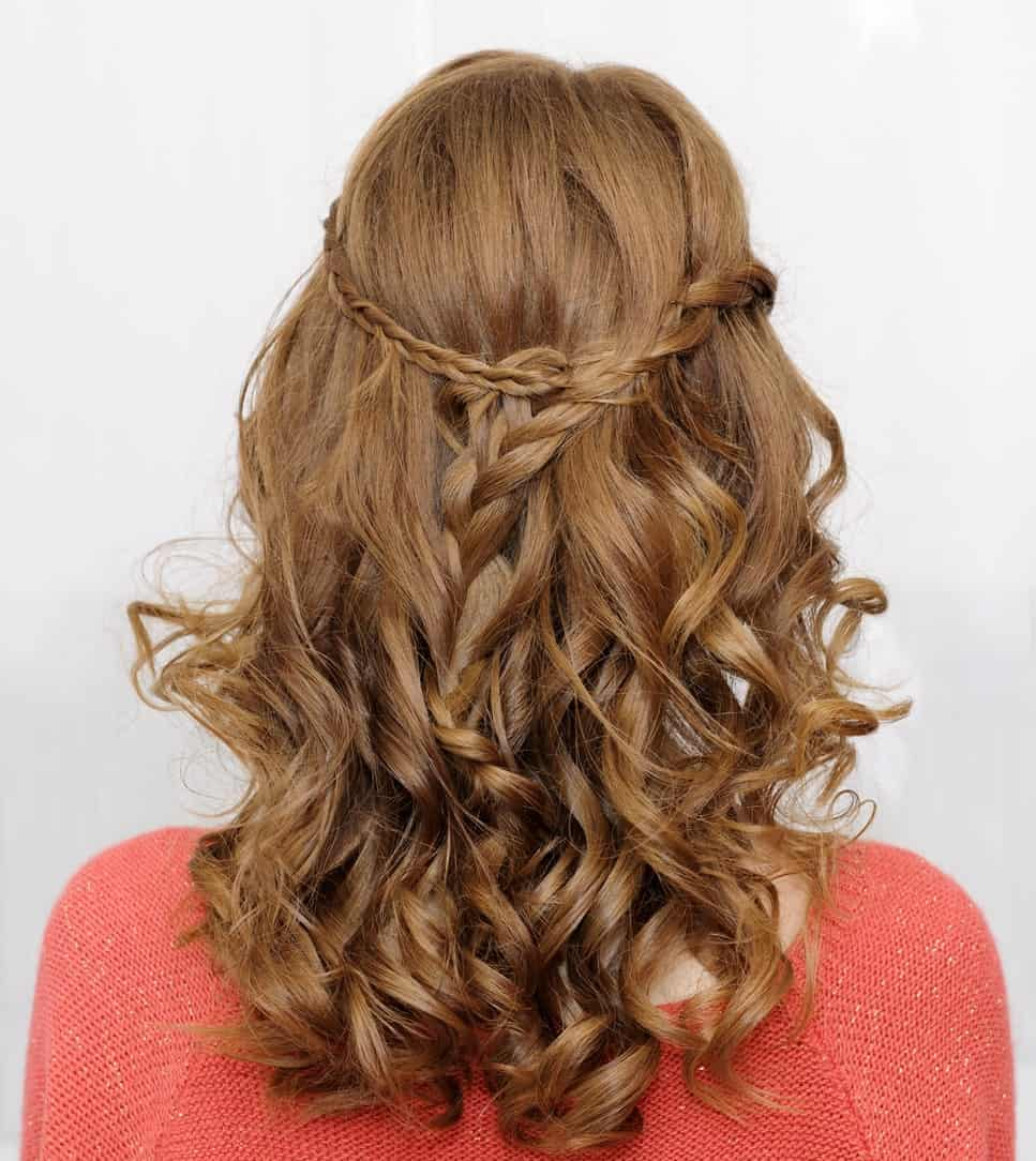 Waterfall hairstyle like this one can go well on various occasions. Bouncy curls give you a young, playful look.