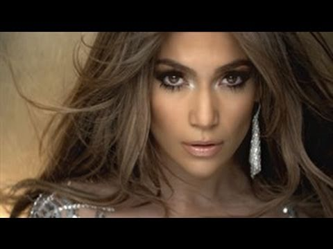 This iconic look by Jennifer Lopez in her music video 'On the Floor' has made side-swept bangs really popular. They are straight bangs that look as if they are flowing freely in the wind and the slightly platinum tones bring out the brown color of the hair.