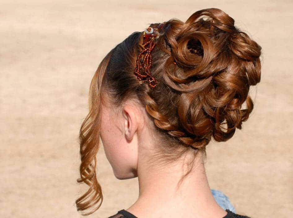 This hairstyle for women with long hair features an extra elaborate bun that is sure to turn heads wherever you go.