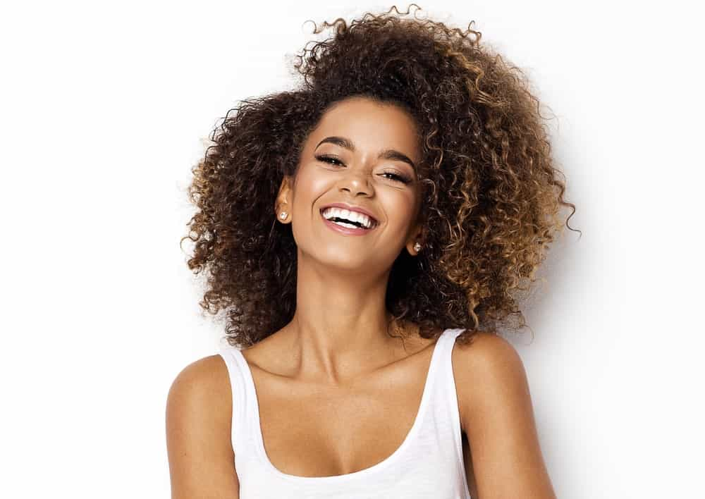 You can sweep your long beautiful tight coils to one side. Long bobs are trending these days, so why not get a curly long bob?