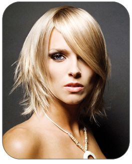 If you have a chiseled face structure, this hairstyle is your best bet. It is jet straight and sleek with side parted long bangs in the front and pointed, pixie-like layers all over.