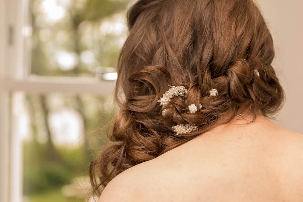 Side swept curls also look really elegant with small, delicate flowers in them. Your hair will look lovely for a formal event.