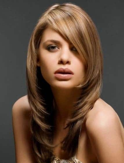 These are inward-going, long layers with side bangs and a gorgeous honey-brown hair dye that gives it a very sophisticated look.