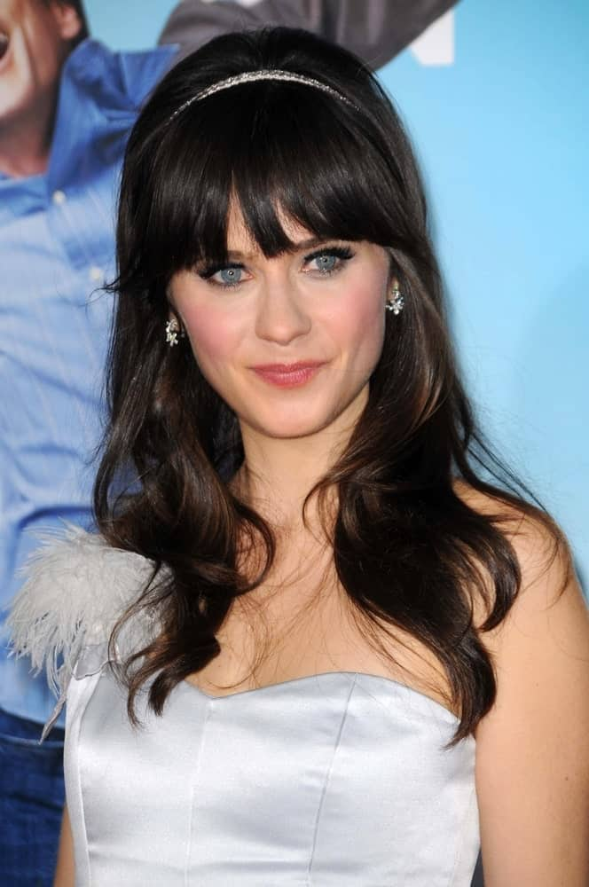"Zooey Deschanel rocked her signature bangs since even before she first started coming on ""New Girl."" Deschanel's blunt cut style has popularized the look among the masses. For people with straight hair, there are lots of options. You can either keep your locks long and flowing or give them a slightly tousled look like Deschanel."