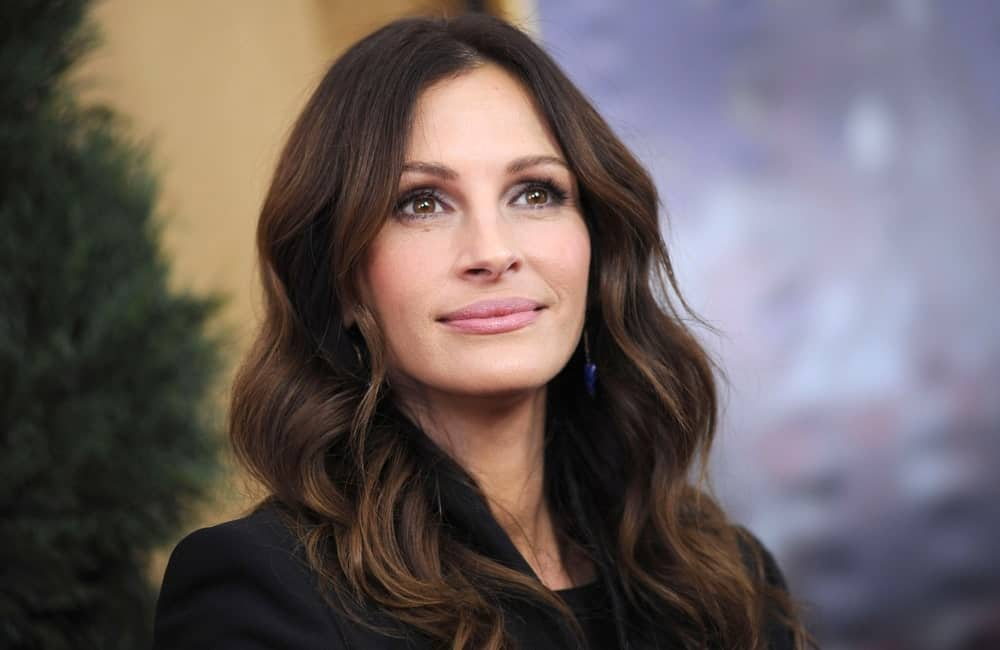 "The ""Pretty Woman"" actress is known for her unique looks as well as her incomparable acting skills. Julia Roberts always creates a stir with her immaculate hairstyle and flawless makeup. Here, the actress is sporting a casual, effortless look with her layered hair in soft curls, with a middle part."