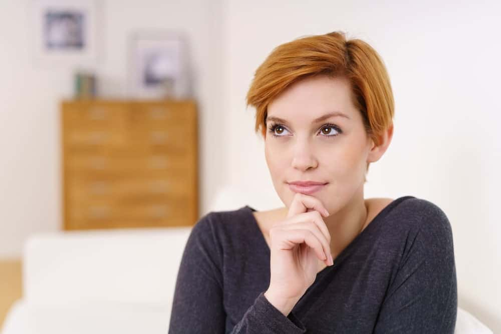 Short hair has been trending for quite some time and with good reason. A straight, short haircut will definitely stand out with your auburn hair.
