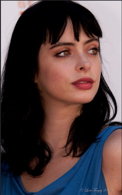 Krysten Ritter has some of the most iconic short bangs hairstyles. Her jet black hair frames her face perfectly, making her look elegant and powerful. The bangs are short enough to make her forehead look smaller but long enough to accentuate her eyes.