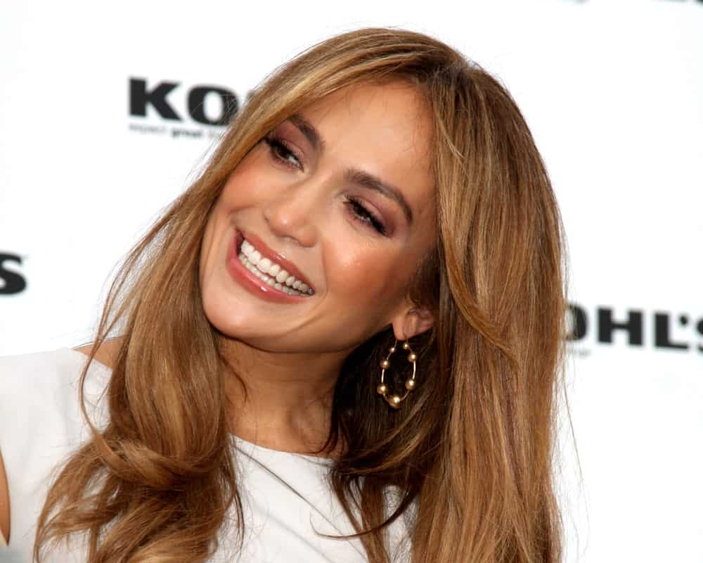 Jennifer Lopez may have played with every shade of brown hair color there is. The singer knows what looks good on her. Here, she has added golden toffee and light caramel-colored highlights to her naturally dark brunette hair. The stunning golden-brown hair, parted in the middle and blow-dried, makes her look years younger.