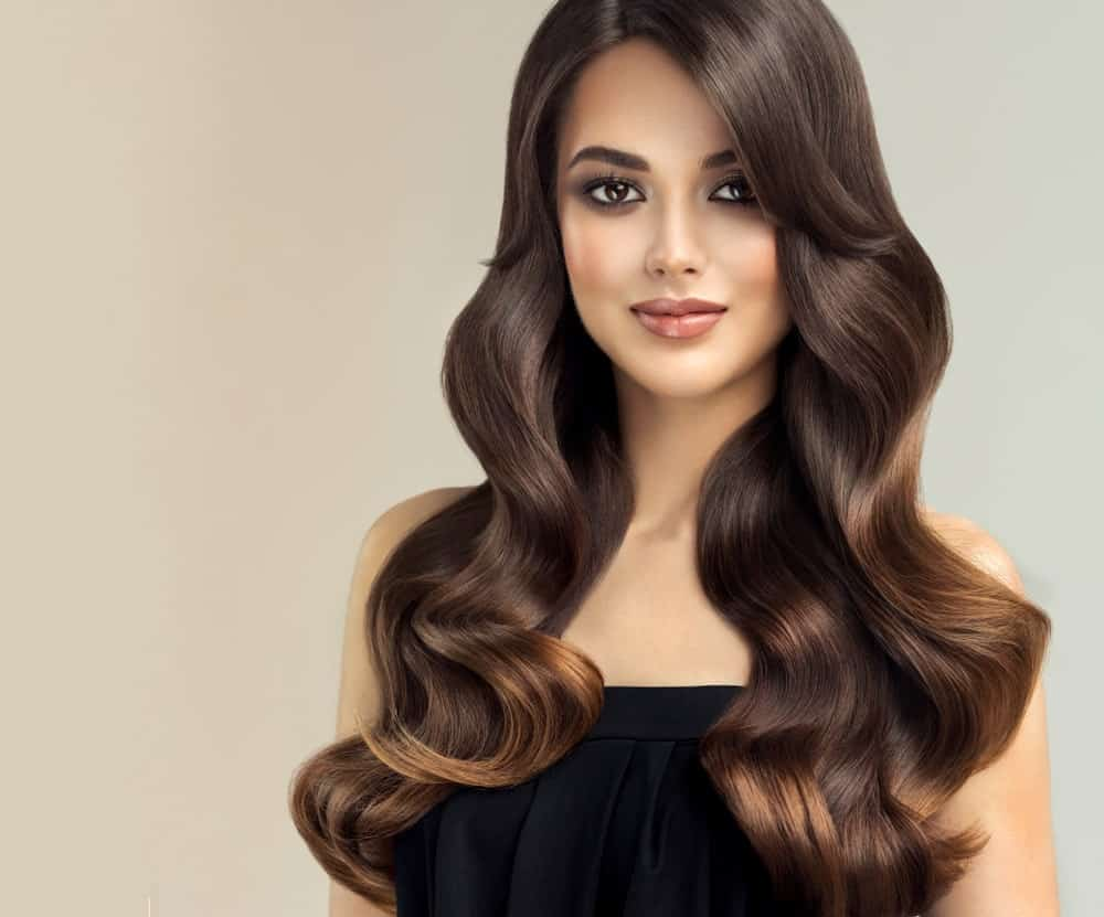 Do you want to add dimension, definition and volume to your hair, without too much drama? Here is the perfect way to do it. Add some subtle but glamorous fiery gold highlights to a background of rich dark hair. The stunning highlights will reflect the light and turn heads at the best moments.