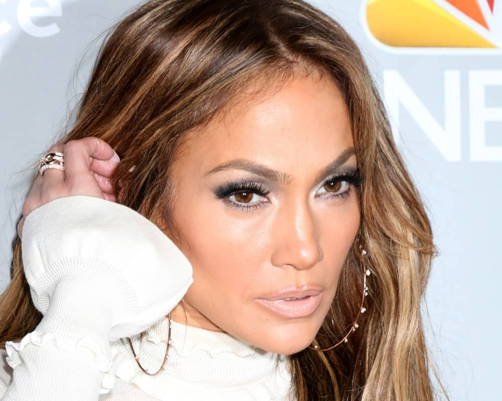 Jennifer Lopez can be seen here sweeping her long bangs to the side. They honeyed tones in her hair bring out the brown warmth of her eyes, making her look stunning.