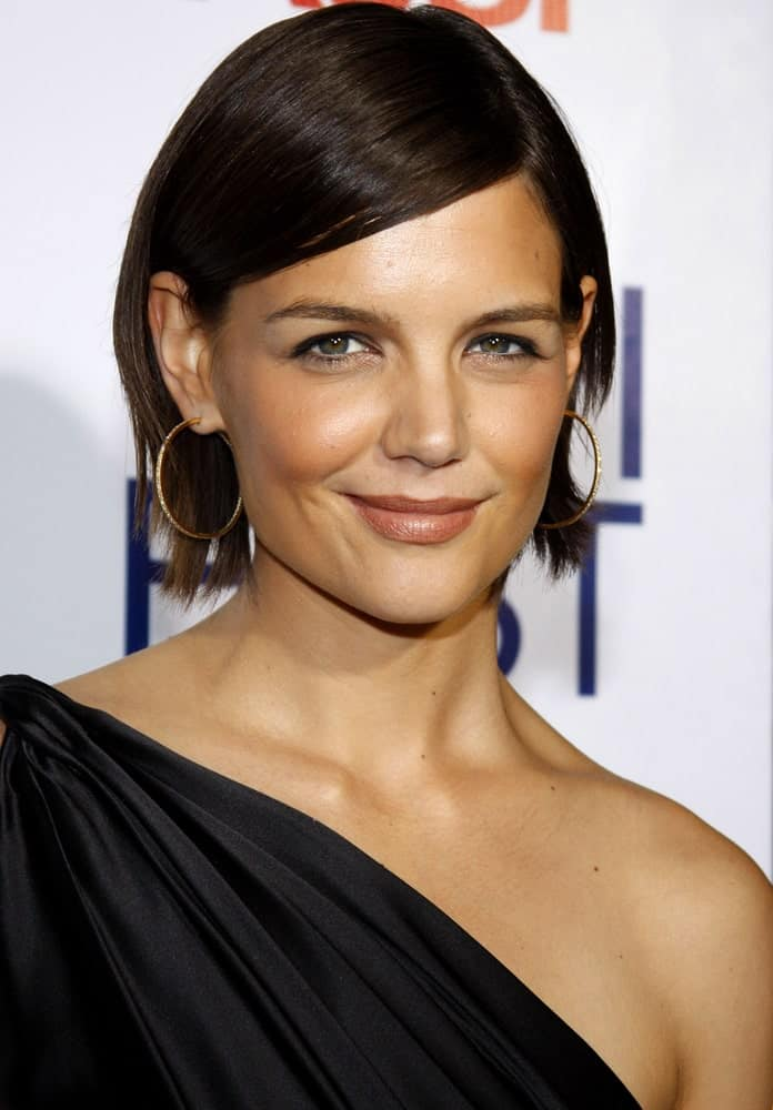 Katie Holmes proves that you don't need to have long hair in order to rock the side-swept bangs haircut. With her silky straight bob, she can be seen sporting a fine hairstyle.
