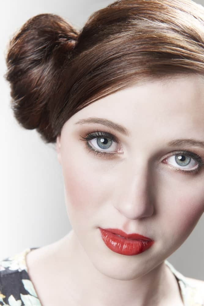 Side buns are a cute look for any day of the week. The natural contrasting colors of auburn hair also amplify the look of this hairstyle.