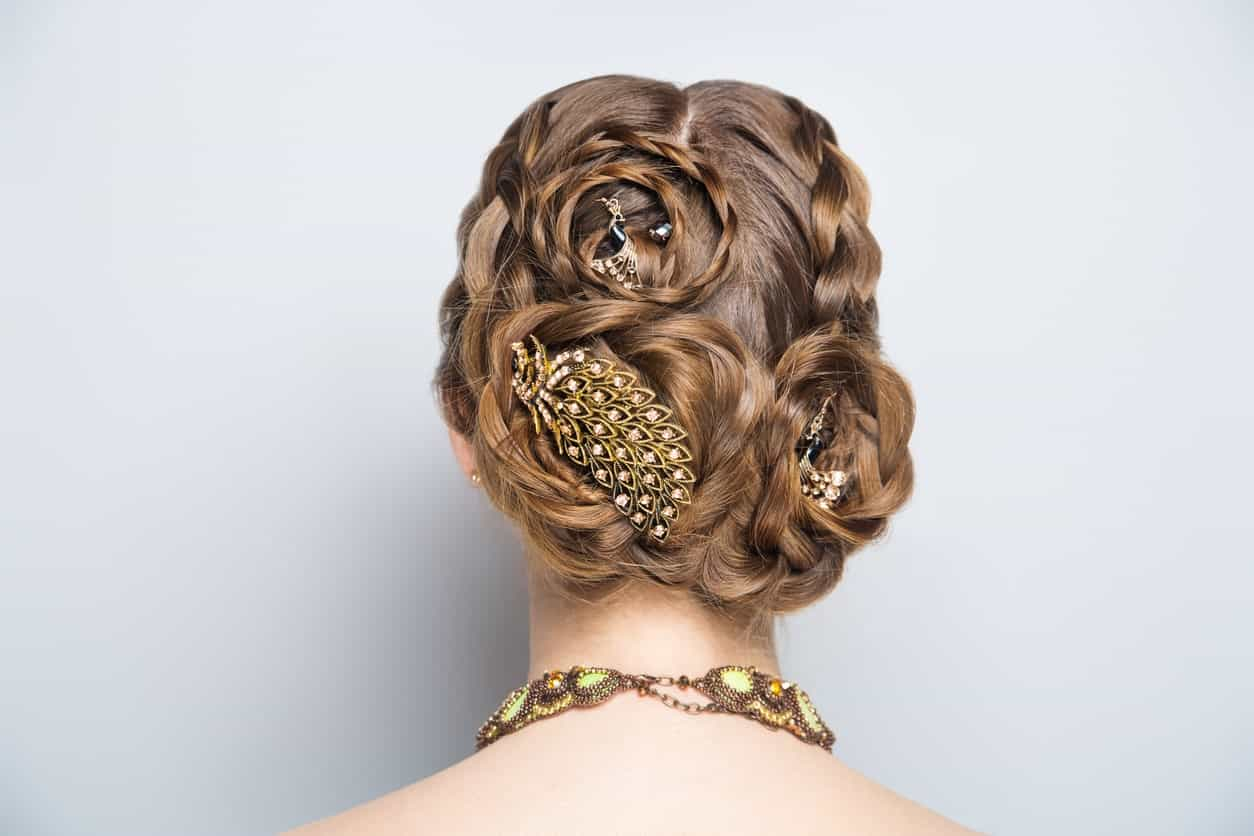 Looking for hairspiration for your wedding? If you have thick and long hair, try a super-intricate hairstyle with lots of braids, multiple twists, and curls in your hair. Embellish it with jeweled accessories.