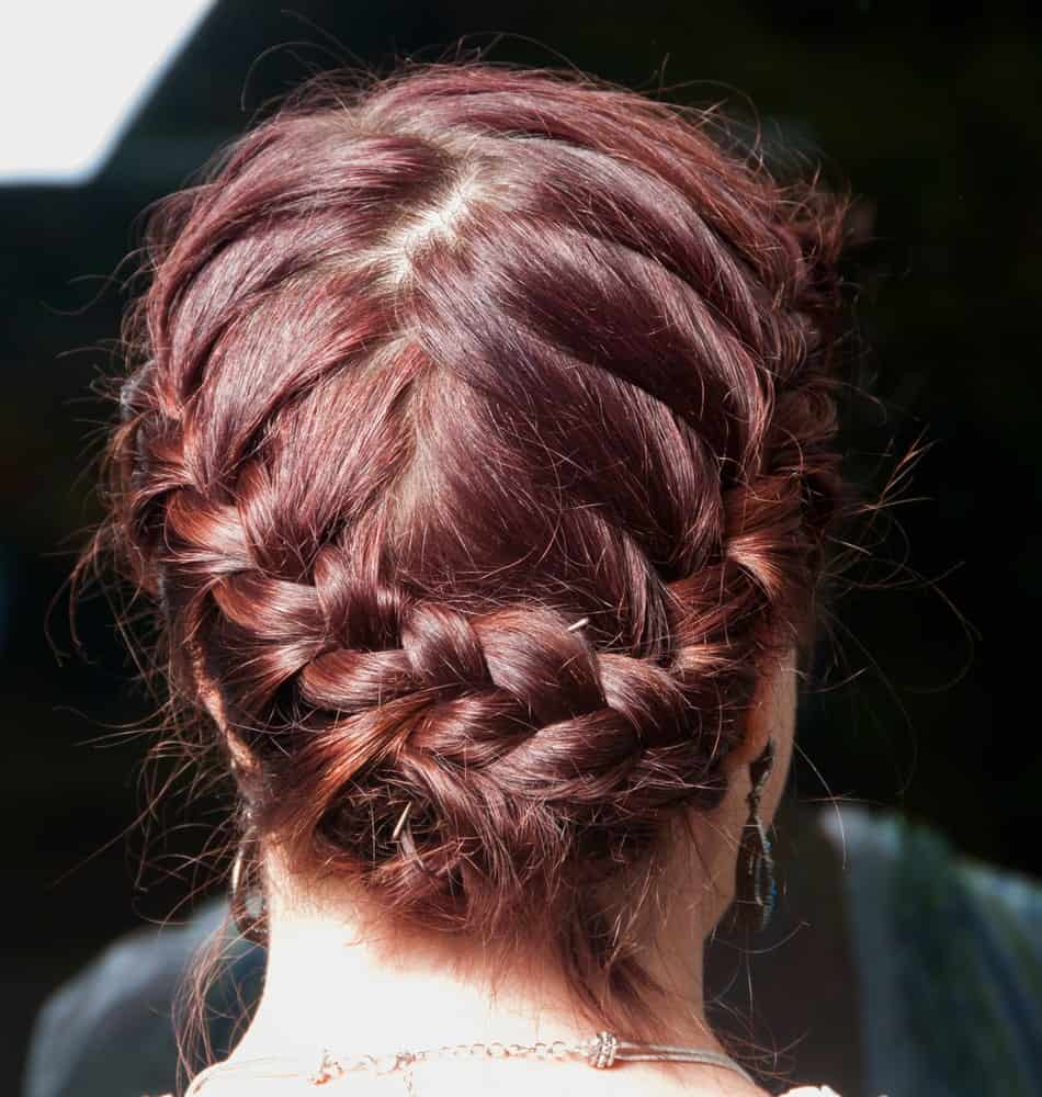 If you want to add a twist to the traditional braid headband that is usually popular for the top of the head, you can switch it out with a gentle U shaped braid band at the base of the neck for an elegant touch.