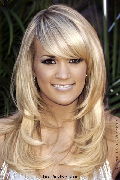 Flickr, Meg We love this side-swept bangs hairstyle sported by Carrie Underwood. The soft feathery cuts of her long blonde hair that perfectly frame her face look simply exquisite.