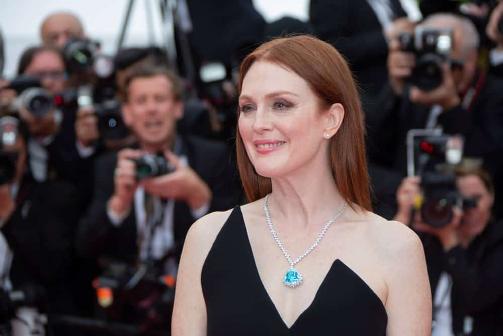 Julianne Moore shows how straight hair doesn't need to be styled elaborately to look beautiful. A simple parting and flowing locks can give a very elegant finish to any look.