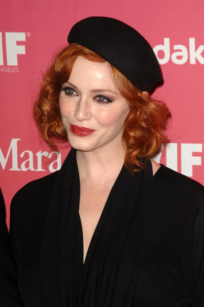 Christina Hendricks is well known for playing around with accessories. She dons this beautiful domed hat with short soft curls for a vintage, black and white movie star effect.