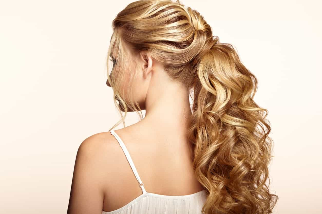 Big curls, slight layers, high ponytail-cum-lose-plait with lots of volume – this hairstyle for women with long hair is simply to die for. Brush out a few thin strands to gently frame the face, which will make you look oh-so-pretty!