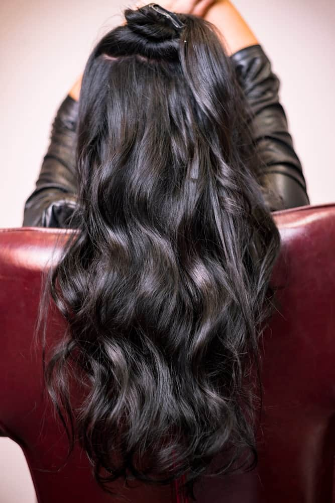 These are perfectly symmetrical wave-like curls that have been swept all the way towards the back.