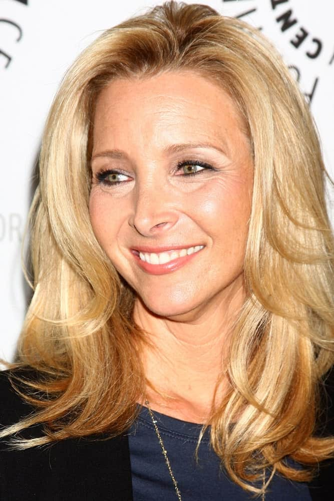 If you are a fan of the ever-famous TV show 'Friends', you will love this gorgeous hairstyle rocked by none other than Lisa Kudrow. With a ruffled and poofy middle parting followed by soft, blended layers, this hairstyle is nothing short of modern and stylish.