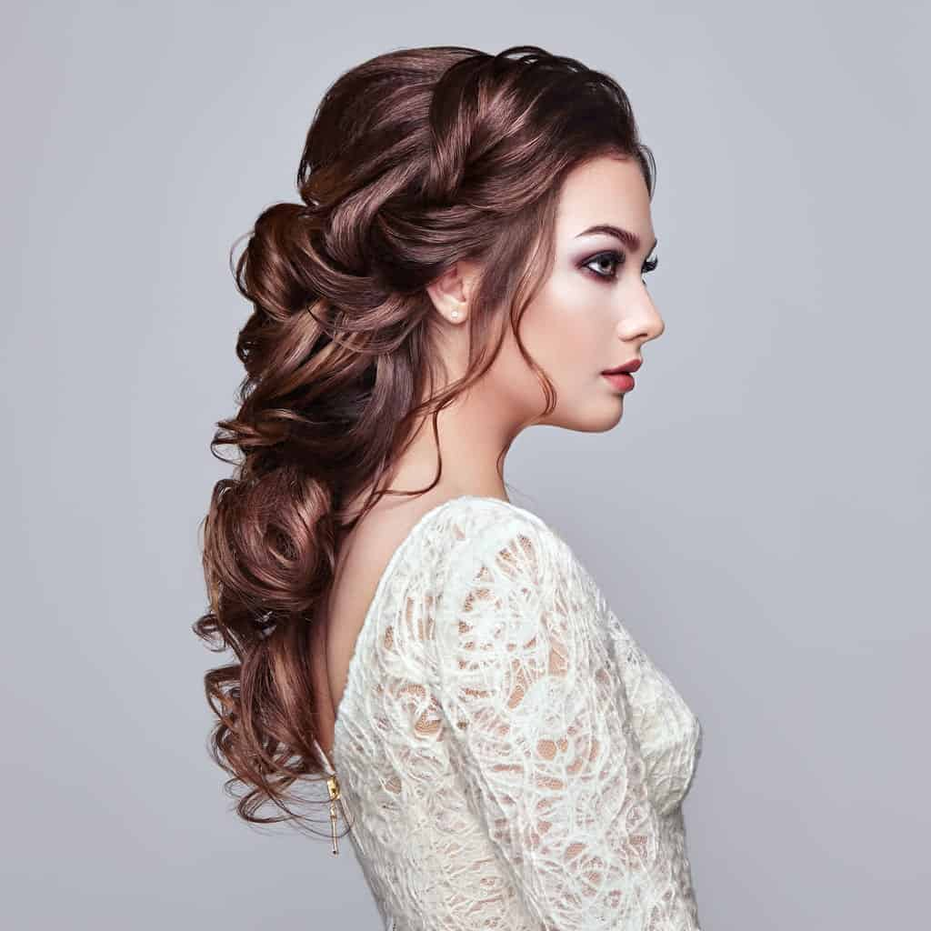 This hairstyle for women with long hair is all about sophistication and elegance. A low ponytail braid is the go-to hairstyle for wedding parties.